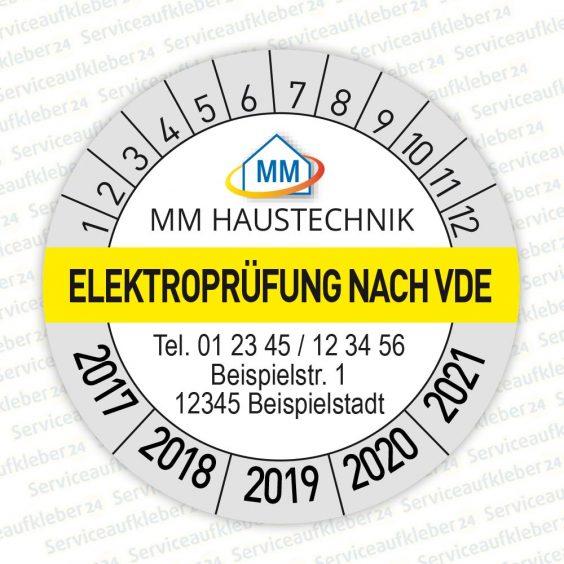 Bild von Prüfplaketten Elektroprüfung VDE mit Aufdruck der Firmenadresse und Logo in Farbe