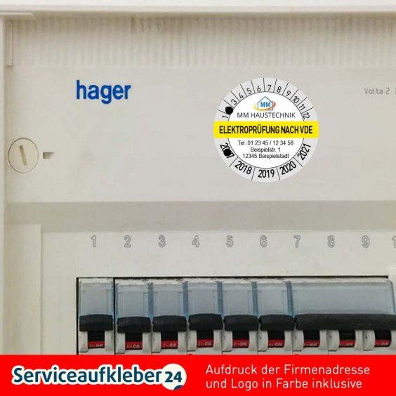 Bild Prüfplaketten Elektroprüfung VDE mit Aufdruck der Firmenadresse und Logo in Farbe aufgeklebt